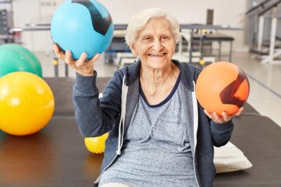 a senior balancing two balls