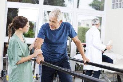 a nurse helping a senior